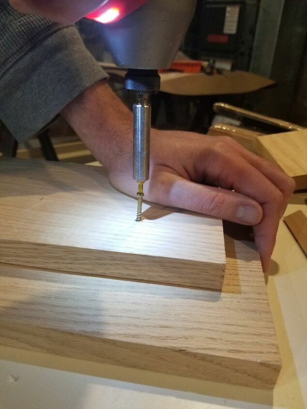 Screwing the two planks together.