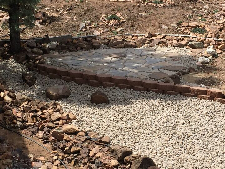 Flagstone patio and lower level river rock.