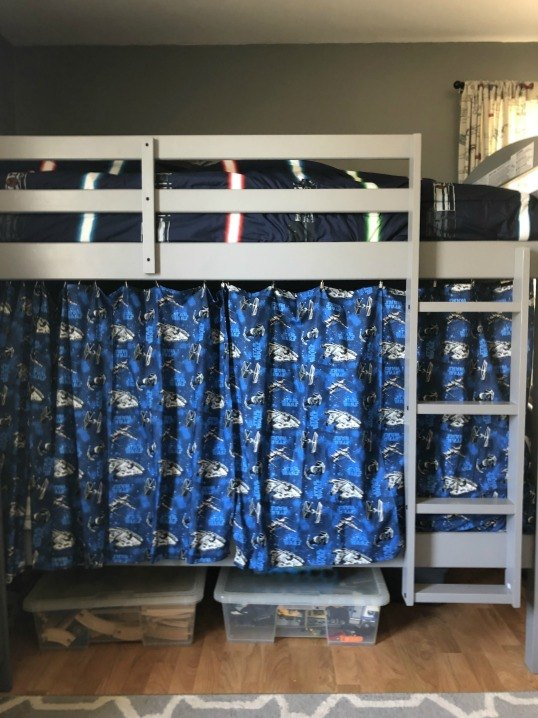 creating a fort with curtains on bunk beds