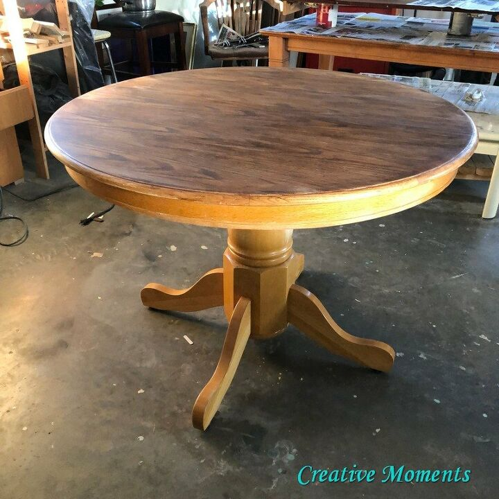 oak dining table is stained over existing finish