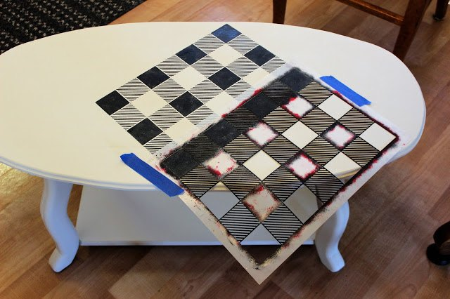 upcycling a dated coffee table with paint and stencils