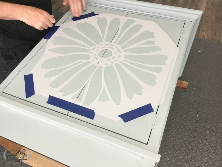 Taping Stencil to Front of Cabinet