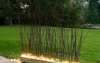 Make A DIY Lit Privacy Fence Using Ikea Branches