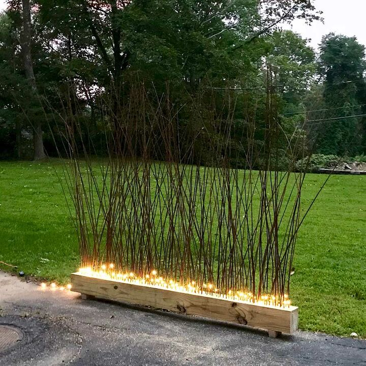 make a diy lighted privacy fence using ikea branches