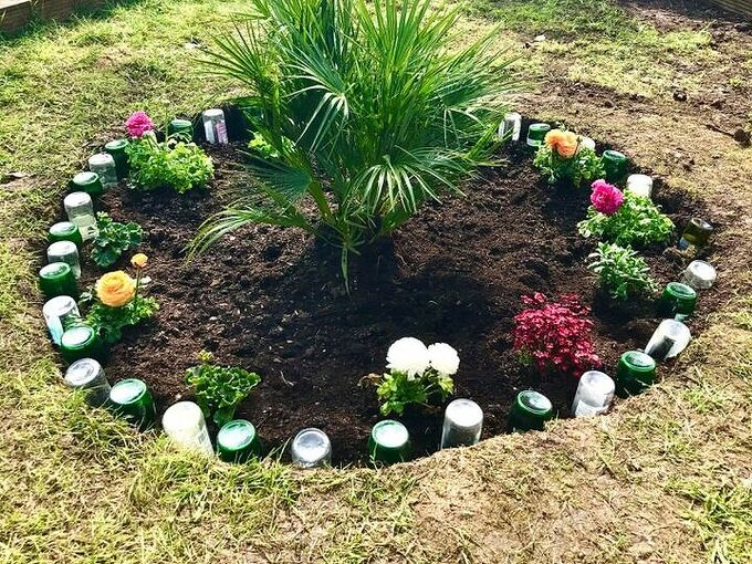 how to use your old glass bottles to create nice flower bed border, Bottle border