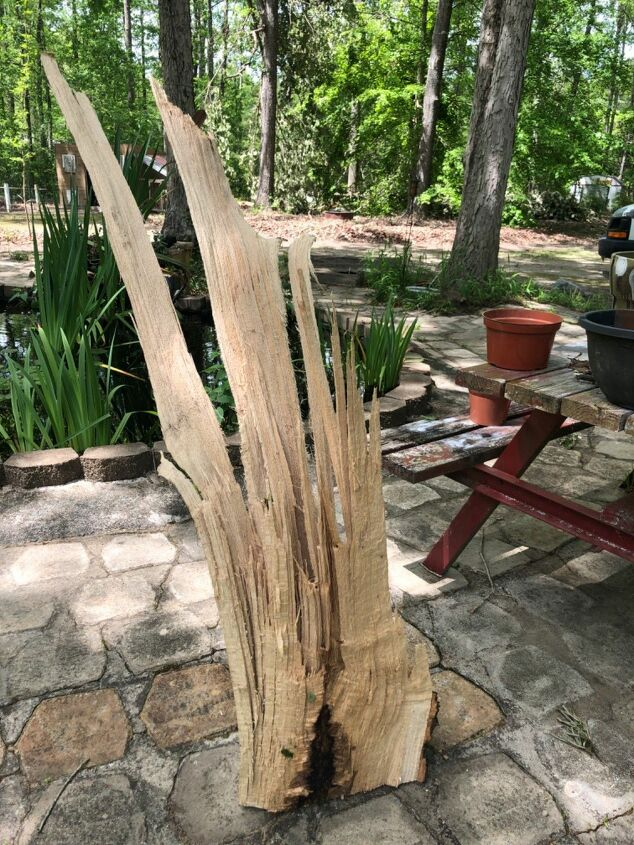 q add a broken tree limb to my flower bed for decoration