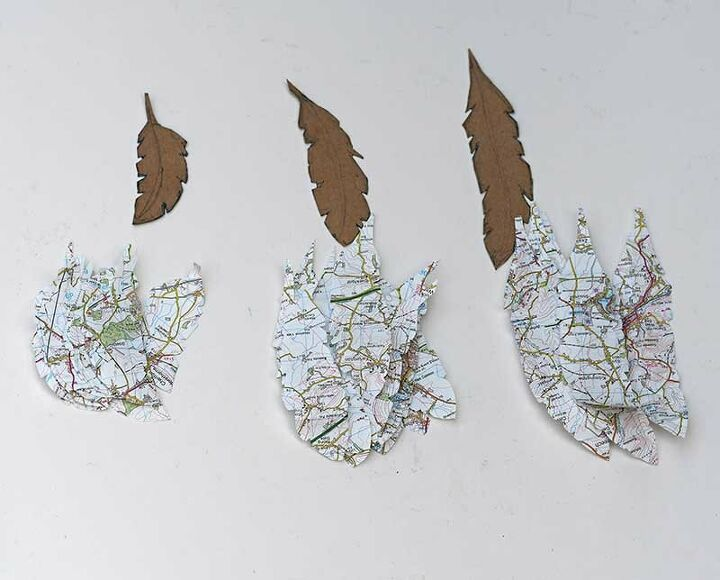 beautiful upcycled map angel wall decor