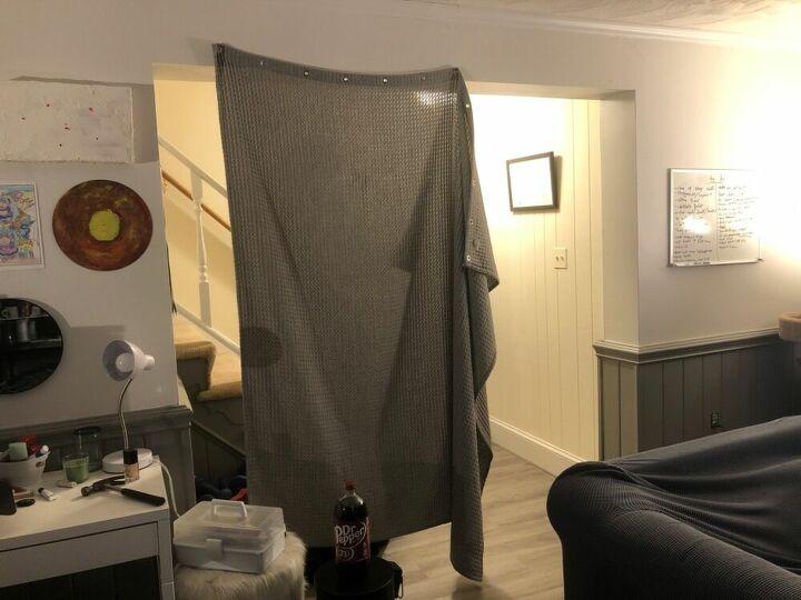 q closing off a basement den