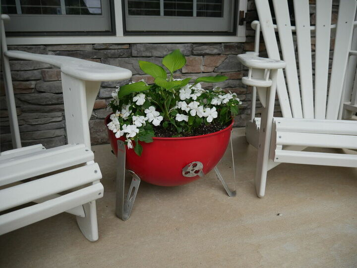 meat smoker finds new life as a lovely flower planter