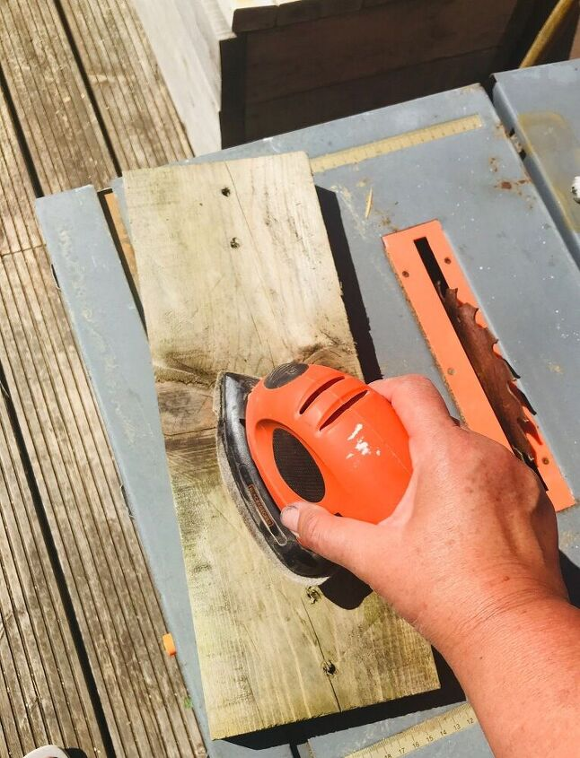 Sanding a plank of wood