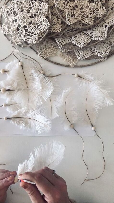 Attaching the feathers to the twine