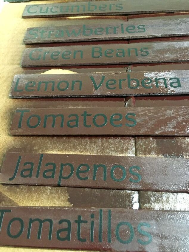 recycled stir sticks turned garden markers