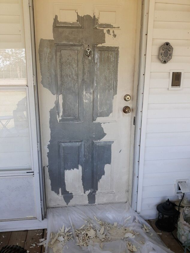 q how to get vinyl paint off a metal mobile home door