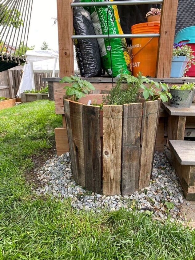 faux wine barrel planter from repurposed fence boards