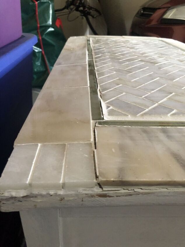 q how to fix tiles that are popping up on a wooden dresser top