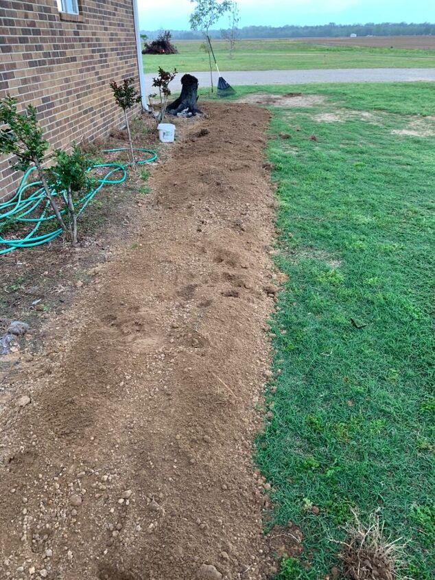 brick sidewalk flowerbed