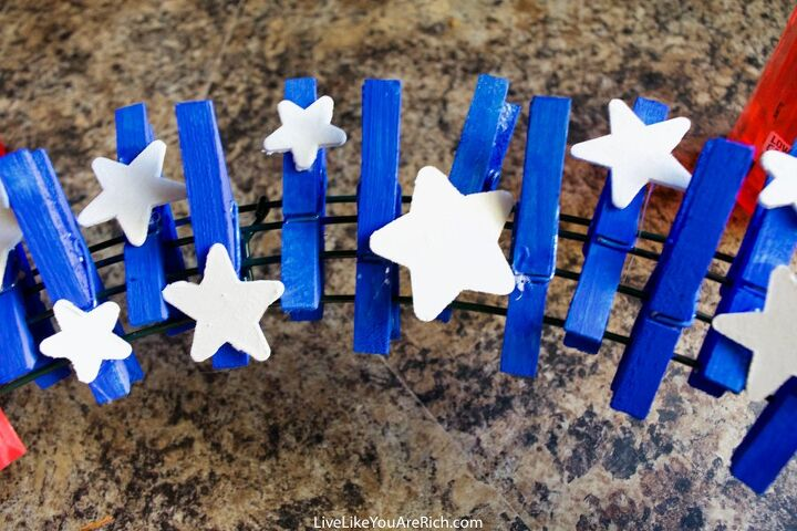 s 10 budget friendly july 4th wreath ideas for front door, Try this dollar store peg wreath idea
