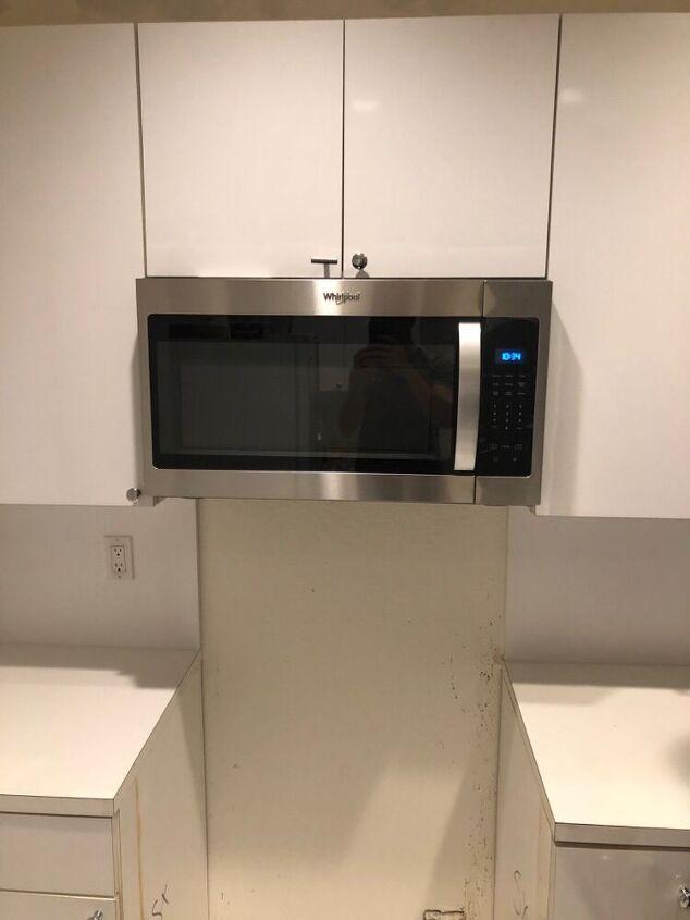 q handyman hung microwave on drywall