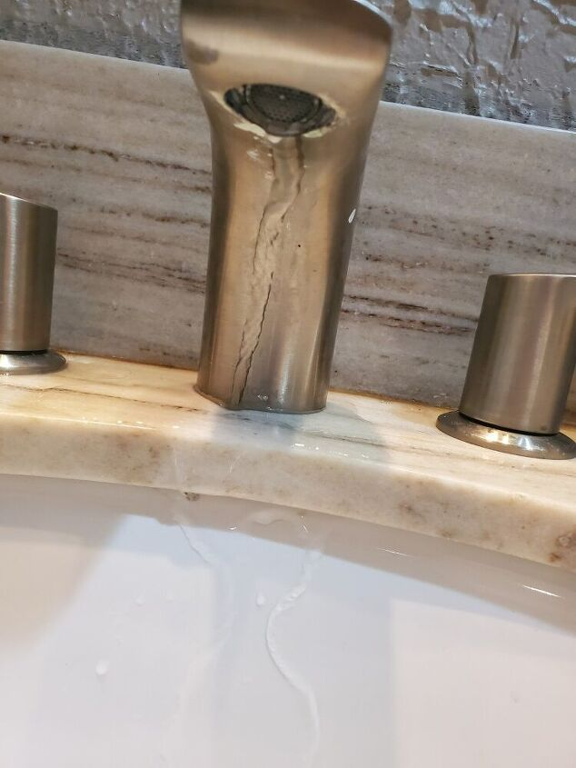 q how do i keel water from going down back of faucet