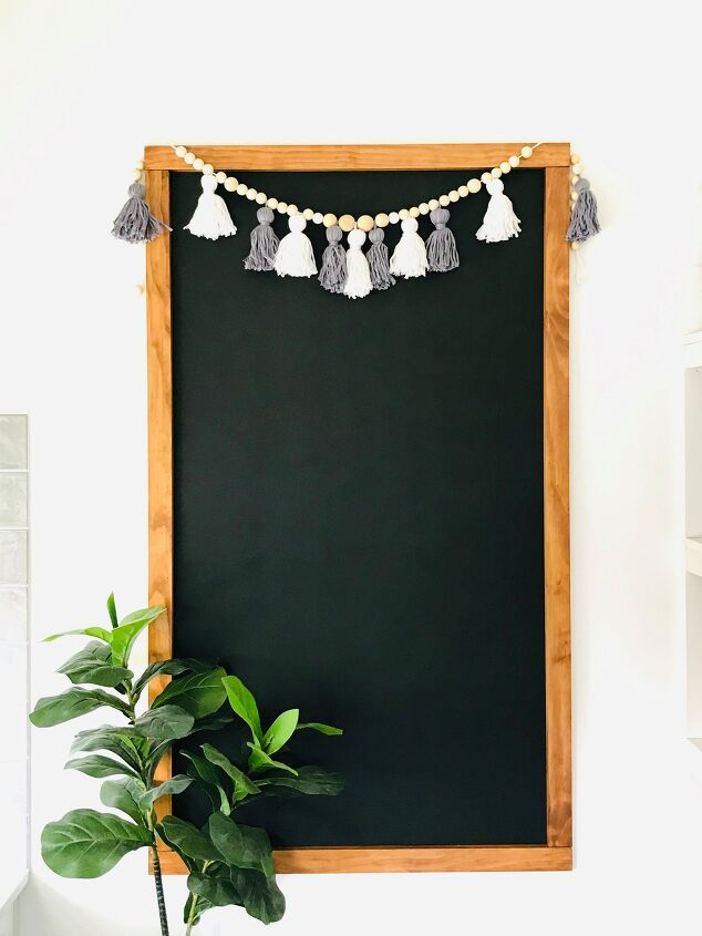 s 18 fun things you can do with a can of chalk board paint, Transform a blank wall