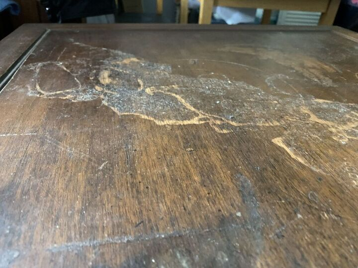 q how do i repair what i think is lifting veneer 50 yr end table