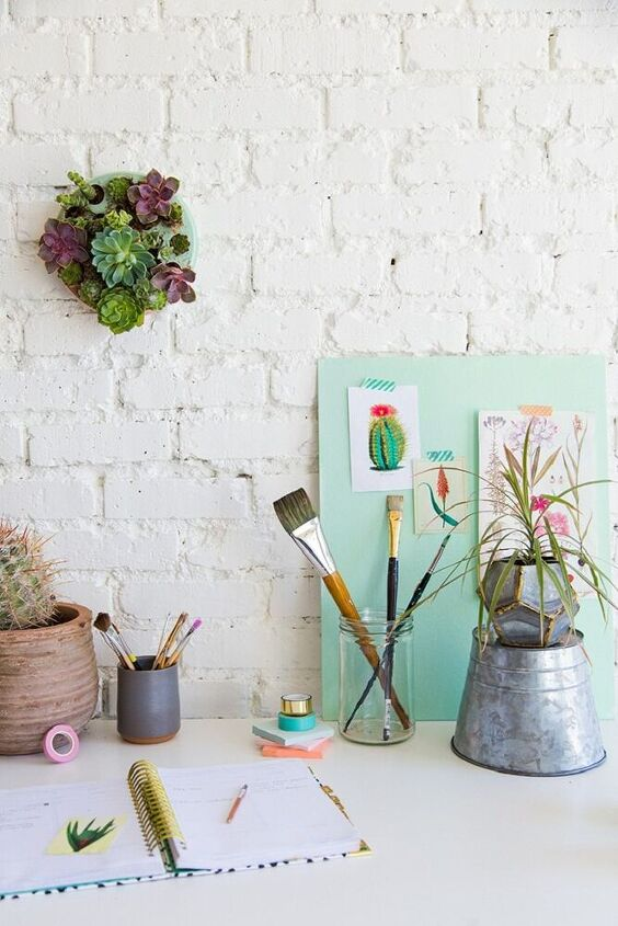 wall pot with succulent plants as decoration
