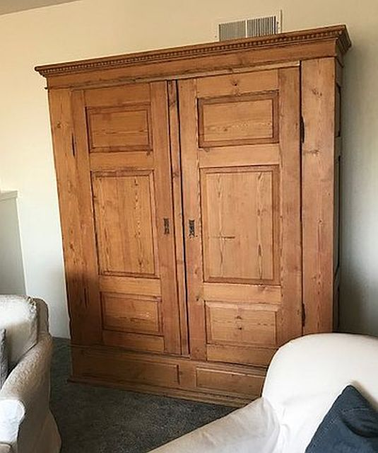 armoire with a weathered wood finish