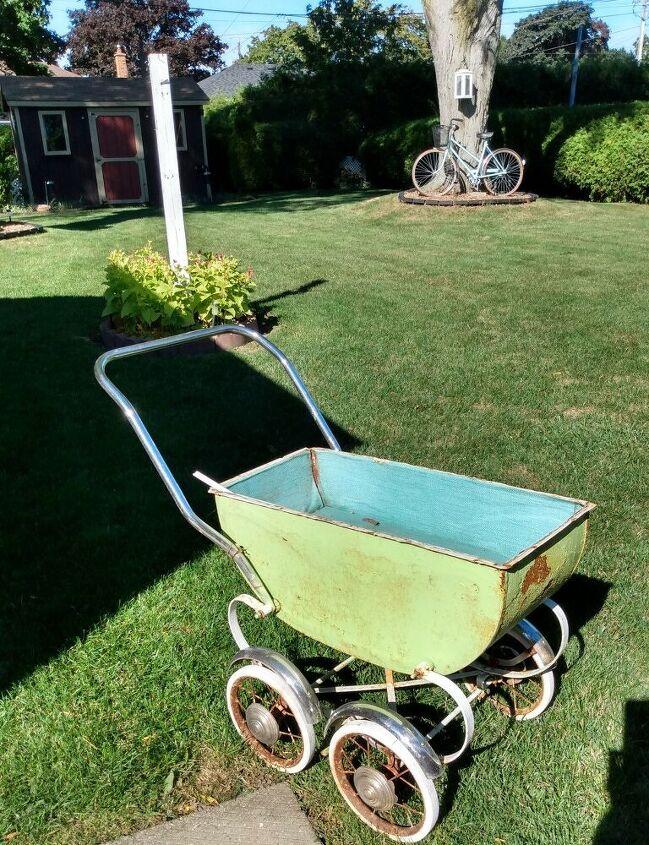 repurposing a baby buggy into fall decor