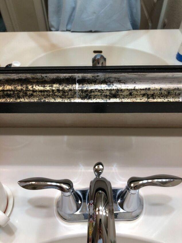 q get rid of dark spots on frame of bathroom mirror