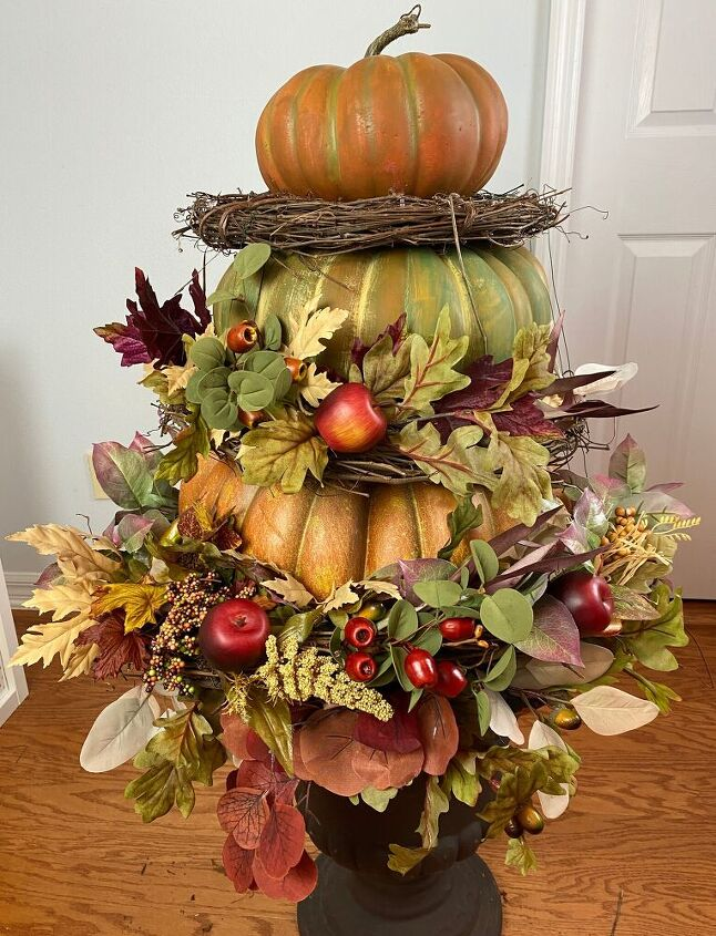 dressing up stacked pumpkins for fall