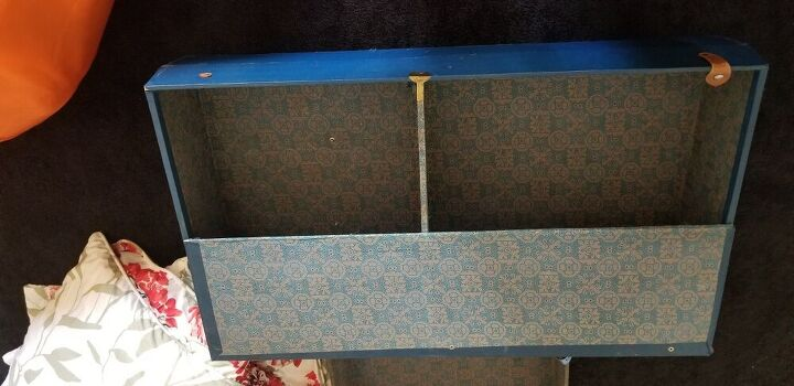 q reupholstering inside a steamer trunk