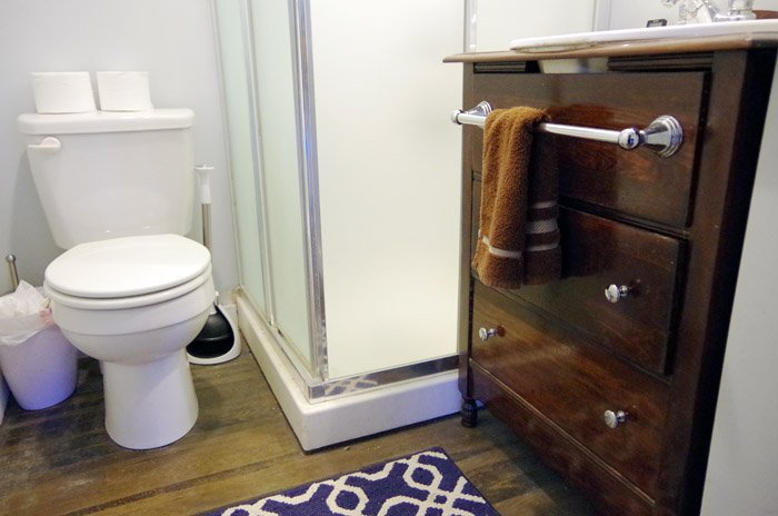 tiny bathroom reveal from embarrassment to moody stunner