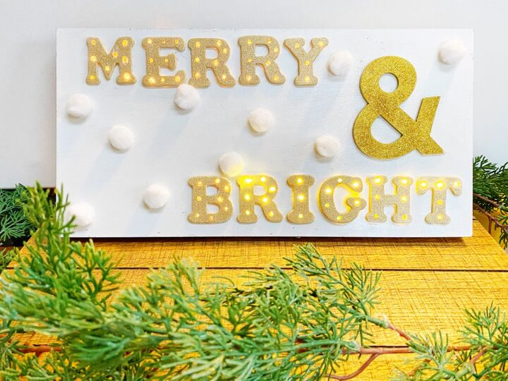 s 30 magical ways to make your home feel more merry and bright, Add Christmas cheer with a bright marquee holiday sign