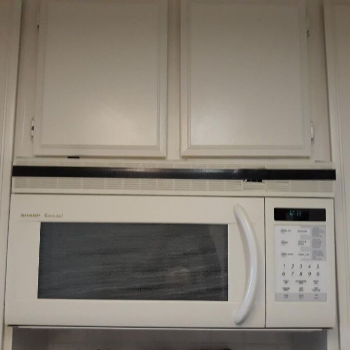 q how can i replace or fix this over stove microwave vent cover brkn