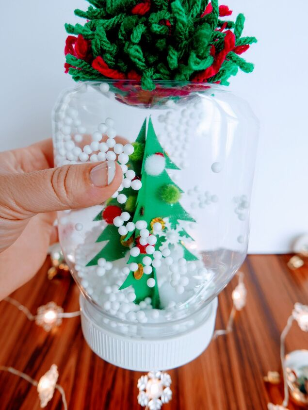 s 15 diy snow globes that make adorable decor and gifts, Make a playful waterless Christmas snow globe