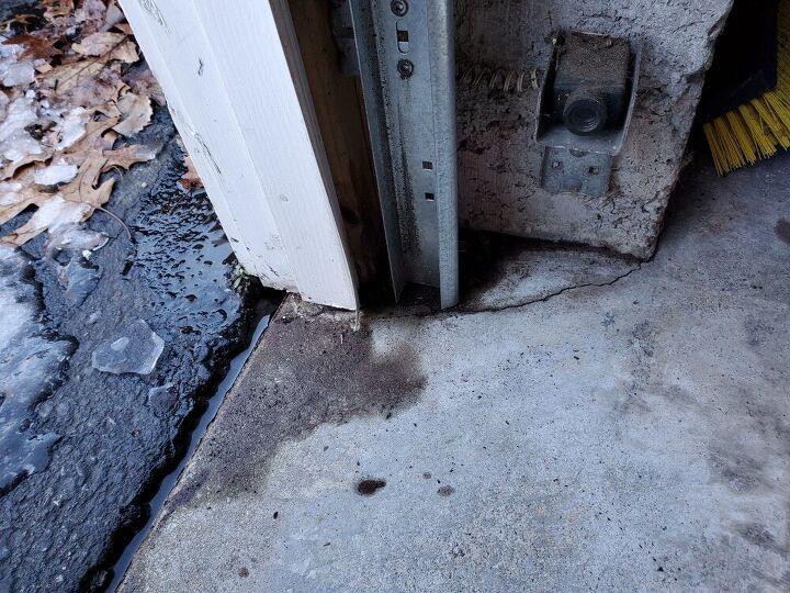 q cracks in garage floor near door worry