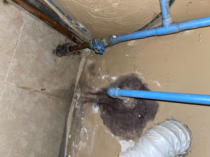 q remove leaking outdoor faucet and fix moldy concrete wall