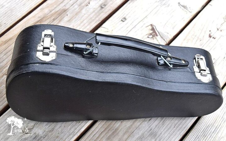upcycled instrument case as pretty wall shelf