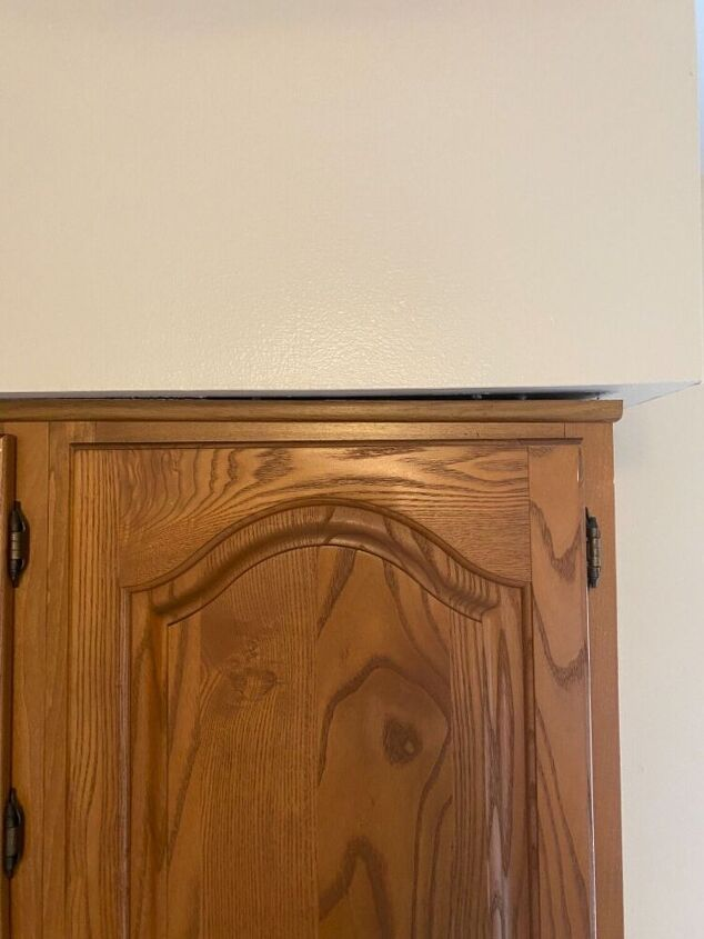 q how to fix gap between kitchen cabinets and soffit