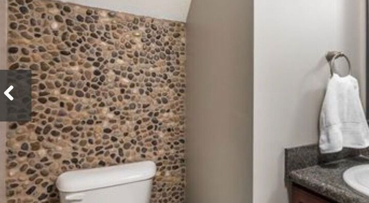 q how can i update this pebble rock wall in my bathroom