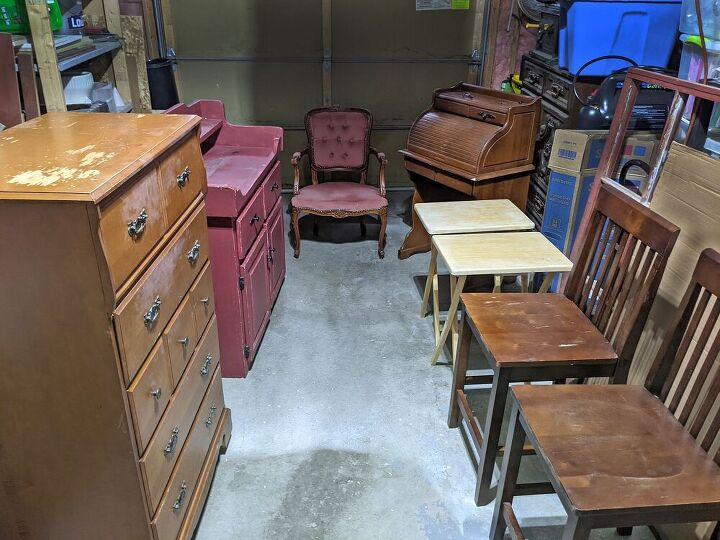 a garage full of old mismatched furniture becomes harmonious, Before