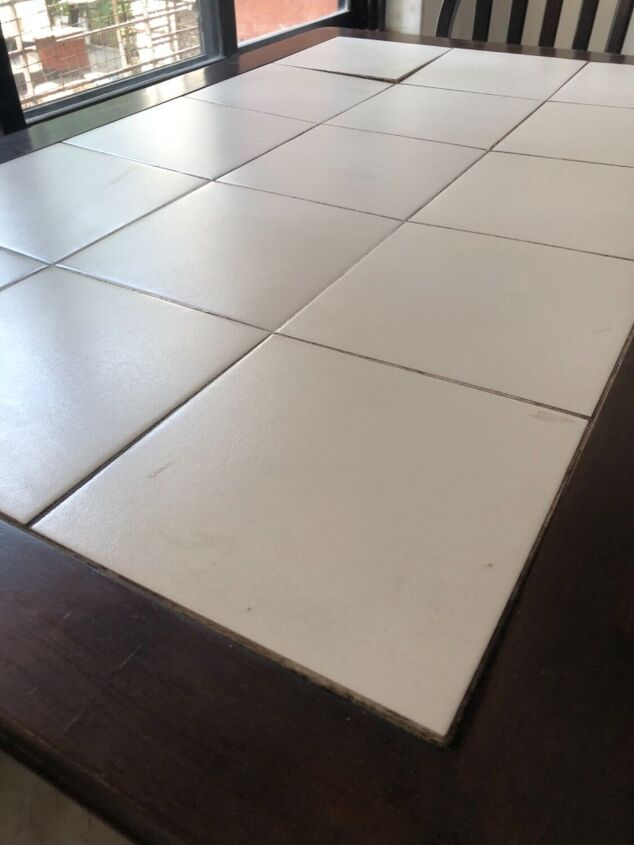 q is this warping tile tabletop fixable