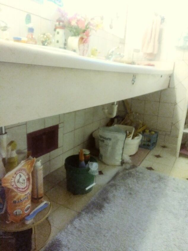 q what can i do under the counter to cover up my bathroom supplies