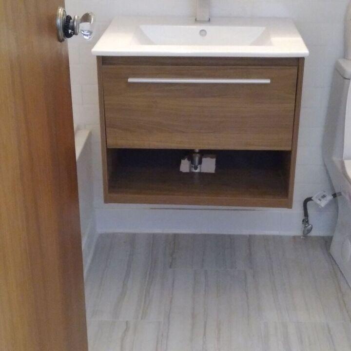 q hiding plumbing on floating vanity