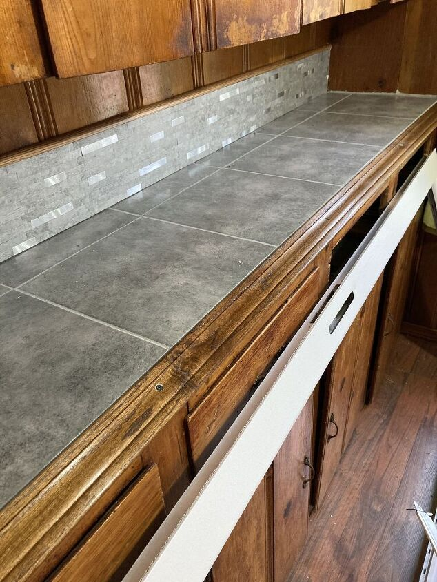 q how to add a clear glossy protective top coat to tile