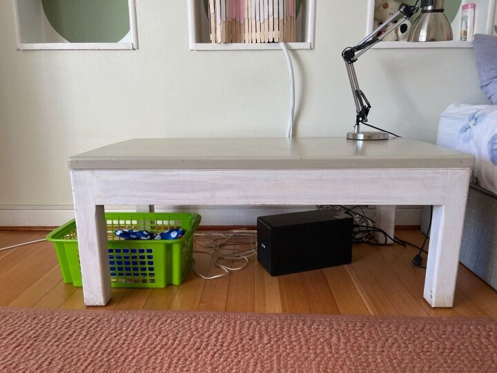 convert a coffee table into seating storage plus a night stand