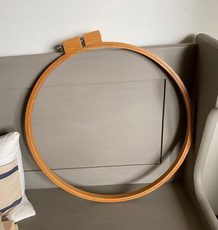 a thrifted wooden quilt hoop frames a stenciled mandala