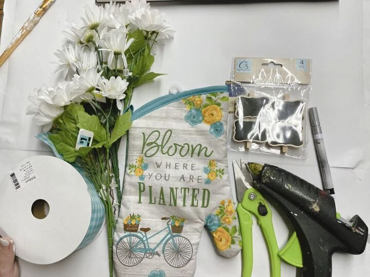make your oven mitt into a beautiful floral bouquet, Firstly you ll need these materials a hot glue gun an oven mitt fake flowers ribbon scissors tags and tissue paper