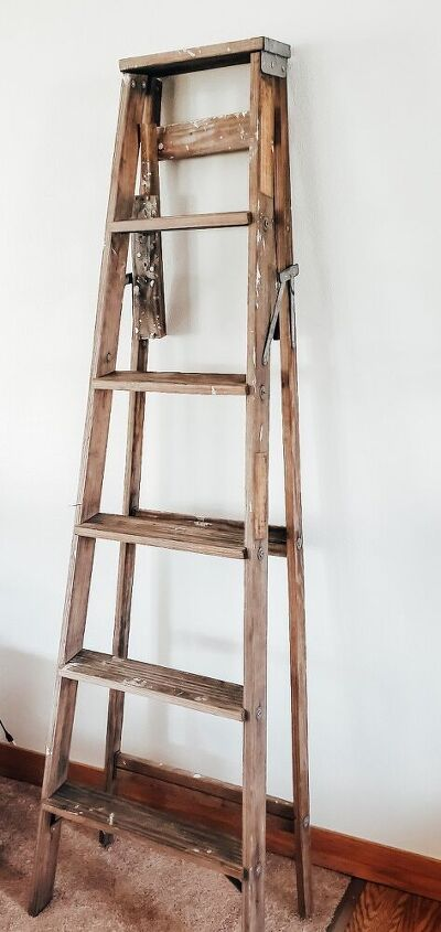 repurposed wood ladder into plant hanger decor piece