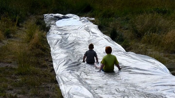 s 25 backyard ideas that ll make your kids summer, A giant slip and slide
